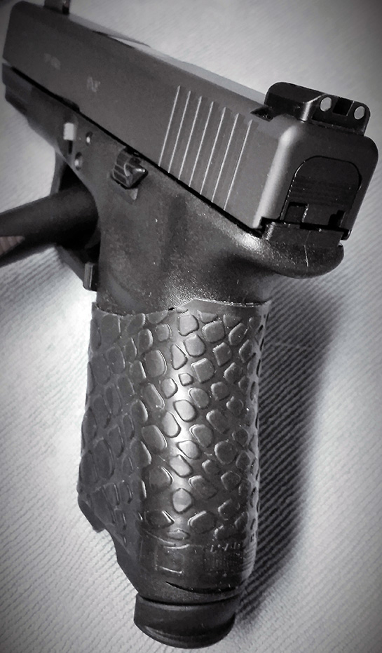 Glock 19 (angled view) with trimmed TUFF1 Black Boa
