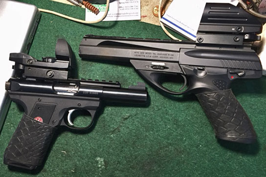 "from J.E. ~""Two of my favorites; Ruger Mark III Target model and a Beretta Neos. Great rim fire steel guns. Love the grips."""
