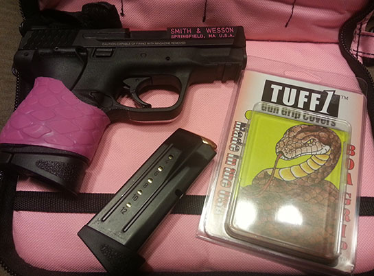 TUFF1 Pink Boa on a S&W M&P 9c with Crimson Trace Laser Grip
