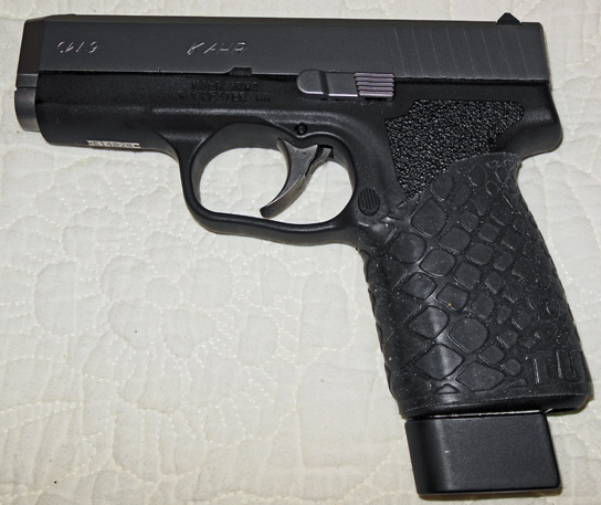"TUFF1 Black Boa on Kahr CW9 ""...nice and easy on the hand because of the heavy KAHR strapping"" ~ B.B."