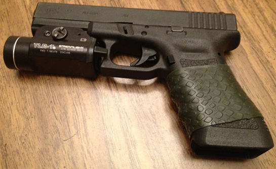 "Glock 22 with TUFF1 OD Green Boa - ""Awesome product. Definitely making this a regular on any future firearms. Thanks."" ~S.Y."
