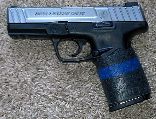 "TUFF1 Boa on S&W SD9VE. ""Thank you TUFF1, for this display of the Thin Blue Line grip to help support law enforcement... Awesome!"""