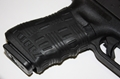 Picture of All Black 2 Pack TUFF1 Gun Grip - Double Cross Grip Black